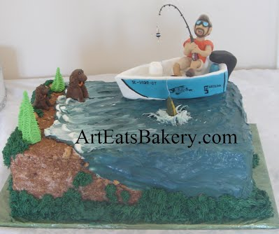 Gone fishing custom unique groom's cake design with edible water, boat, sugar figure man, fish, dogs, trees and grass.