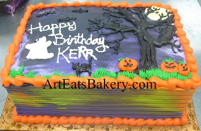 Halloween orange, purple, green and black butter cream birthday cake with pumpkins, black cat and ghost