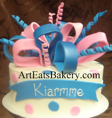 Pink and blue polka dot fondant custom unique girl's birthday cake design idea with edible bow topper