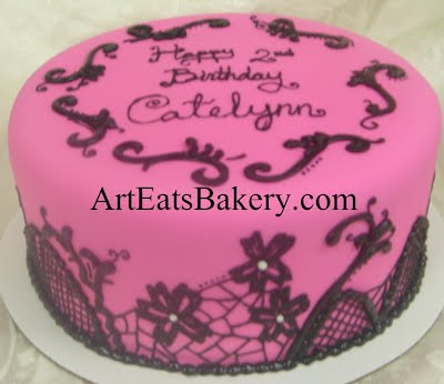 Pink fondant custom girl's or lady's birthday cake design idea with black royal icing lace and flowers