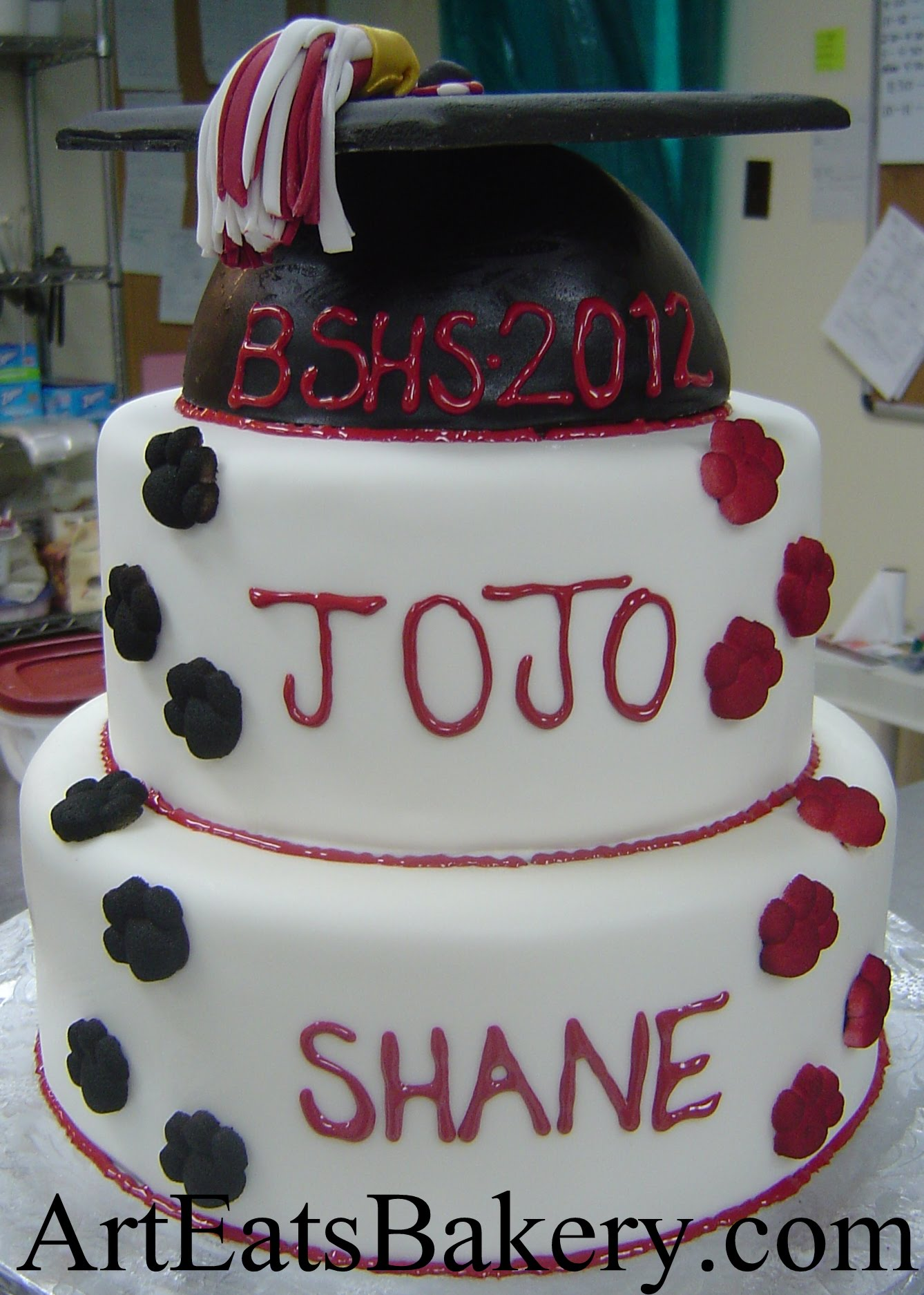 Perfect Two Tier White, Black And Red Unique Custom Graduation Cake Design Idea  With Cap Topper