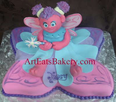 3D Sesame Street Abby Cadabby sitting on pink and purple butterfly custom creative girl's fondant birthday cake design
