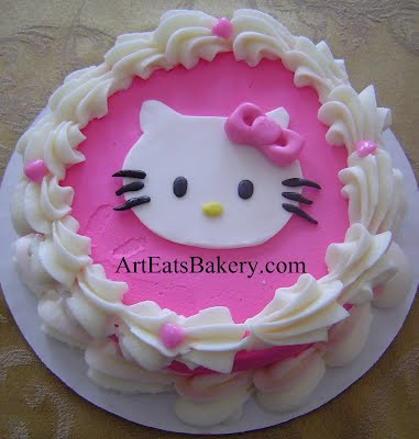 Pink and white butter cream girl's Hello Kitty unique custom birthday cake