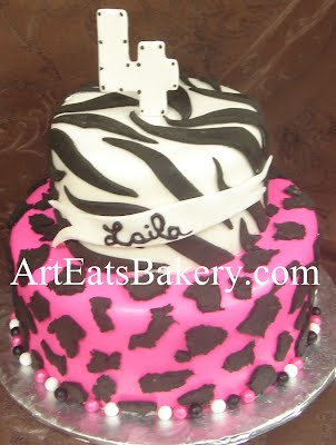 Two tier creative custom girl's animal print black, white and pink zebra and cheeta 4th birthday cake idea picture
