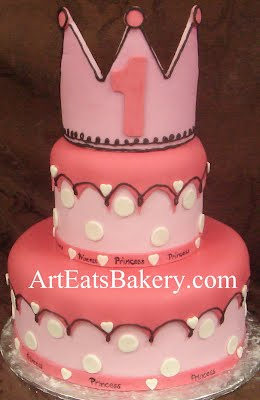 Two tier pink princess polka dot girls 1st birthday cake desing idea with edible crown topper