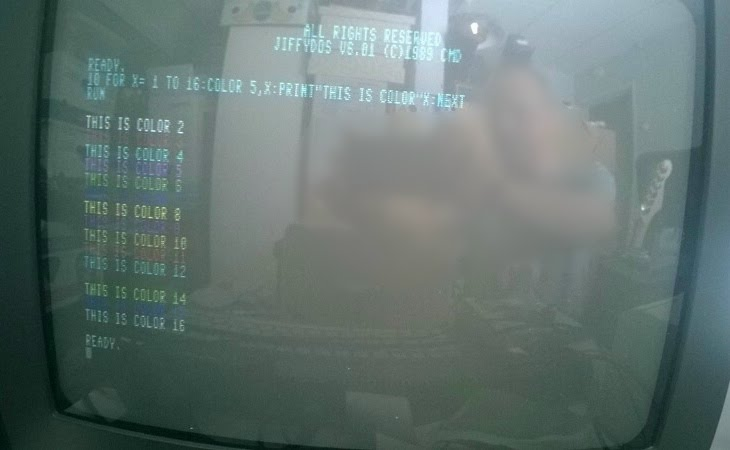 Photo of SCART TV displaying 80-column mode with all 16 colors