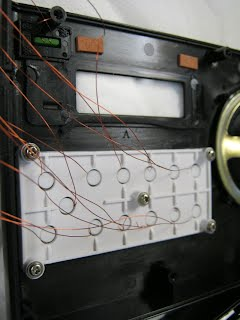 The wires connect to the touch sensor circuitry.