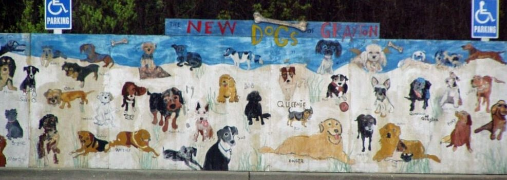 8f697161 While walking around I did see a cute fence all painted up with dogs.