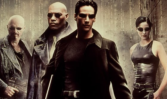 Middle Neo(Keanu Reeves), Second from the left Morpheus(Laurence Fishburne), right Trinity(Carrie-Anne Moss) and left Cypher(Joe Pantoliano) in the Matrix