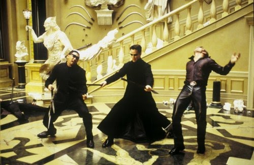 Neo(Keanu Reeves) battles some Programs in the Matrix Reloaded