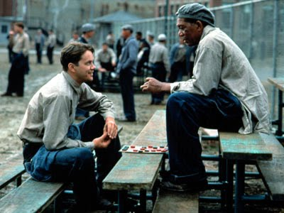Andy Dufresne(Tim Robbins) and Red(Morgan Freeman) playing a game of checkers