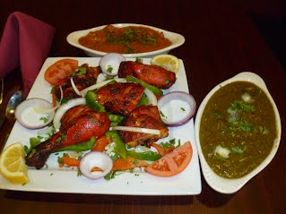 Menu Food Items (Top Left to Right) Butter Chicken, Tandoori Chicken & Palak Panner.
