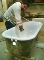 Rafael spraying a tub at our warehouse