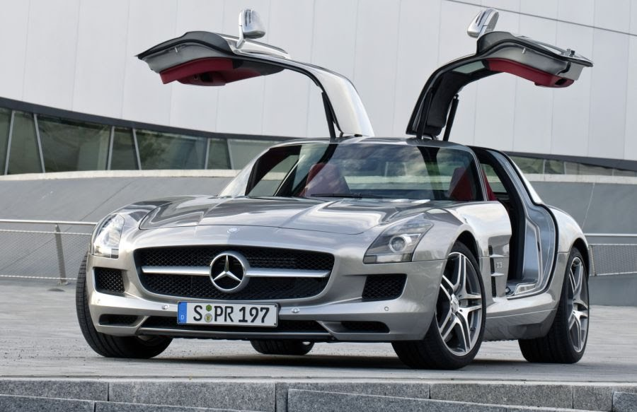 http://sites.google.com/site/investincars/_/rsrc/1258124087528/car-critics-blog/_draft_post-16/2010%20Mercedes%20SLS%20AMG%20Gullwing%20Front%20in%20Silver%20with%20doors%20open%20-%20Qs%20Car%20Review%20Car%20Pictures.jpg