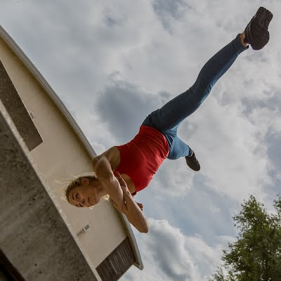Photo of a lady performing an aerial cartwheel