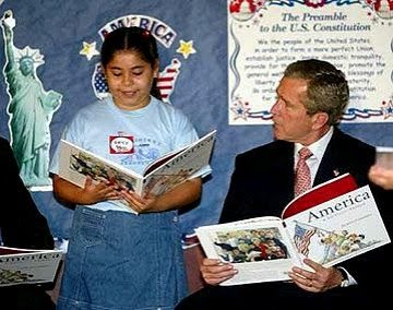 This is the correct, undoctored photo of President Bush reading the book with the school girl. The doctored version showed the book upside down in the President's hands.