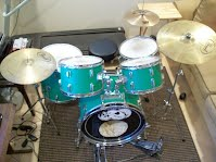example photo of green more expensive student model drums