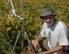 Joe in field with anemometer