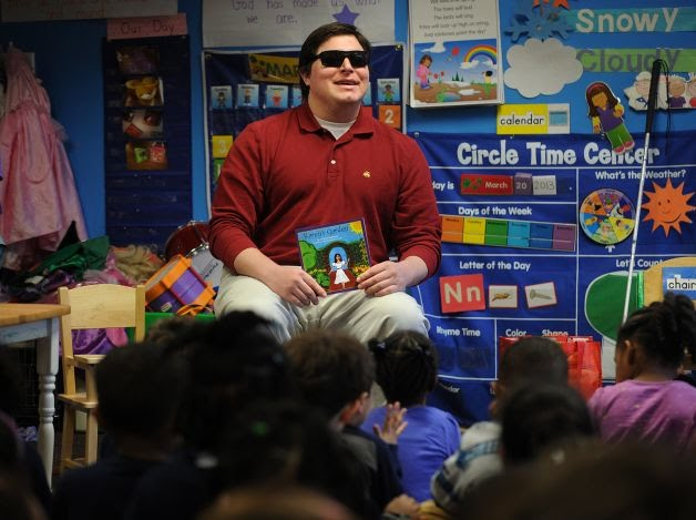 Andrew reading to the kids at St. Andrews