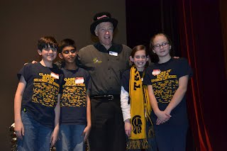 When winning U.S. team from poses with Quizmaster  Wayne Mills