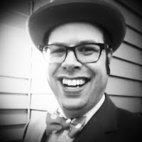 Jim Windisch wearing a hat and bowtie
