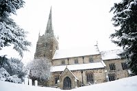 church as the snow falls