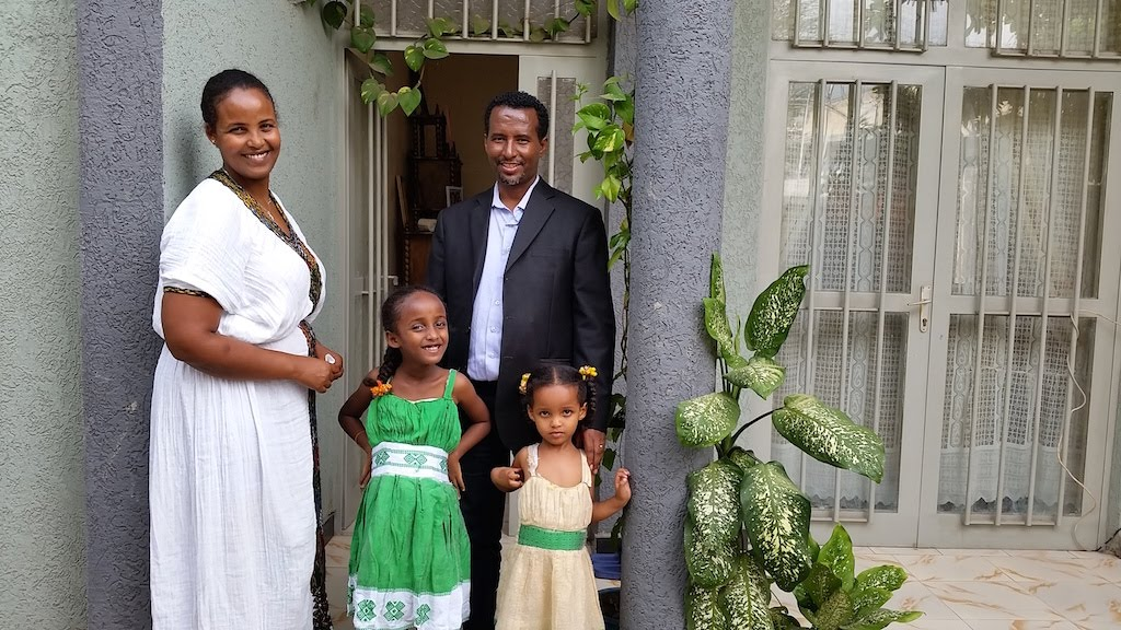 Ayele's family in front of their house
