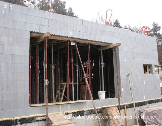 Construction of 1st floor concrete slab in a low energy for Building a house on a slab