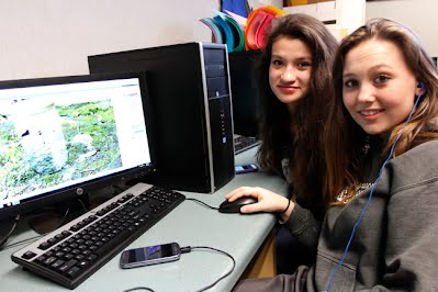 Aurora and Brittany working in Photoshop
