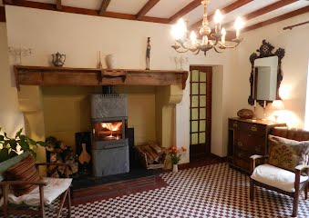 Cosy second sitting room with wood-burner