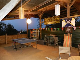 Table tennis table and games area at night