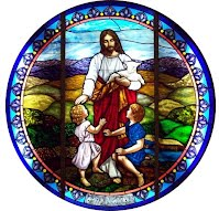 Glass in our church's connector depicting Jesus helping children.