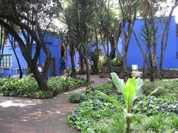 Courtyard of Mexico City house with blue walls where Frida Khalo lived.