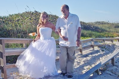 Walking down the aisle with someone special is a wedding picture that can't be missed