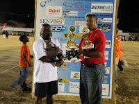 Wakely Daniel accepts trophies for Gender Champions (Male & Female) in Division A & B from Digicel representative
