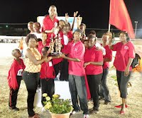 St. James Primary receives Division B trophy from the patron, Leosha Wyatt