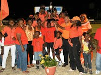 Charlestown Primary receives Division A trophy from John Barkley of Gulf Insurance