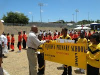 Minister of Social Development (Youth & Sports), Hon. Hensley Daniel inspect St John's Primary at the opening ceremony