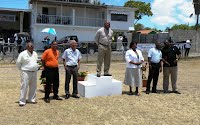 Left to Right: Neville McCook (NACAC President/IAAF representative), John Barkley (Operations Manager - Gulf), Arthur Evelyn (Gulf local agent), Hon. Hensley Daniel (Minister of Social Development), Jennifer Hodge (Principal Education Officer), Alstead Pemberton (Permanent Secretary - Youth & Sports), Jerome Rawlins (LIME) at the opening ceremony
