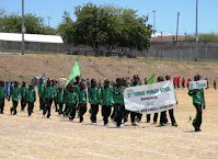 St. Thomas' Primary in the March Past of athletes at the opening ceremony