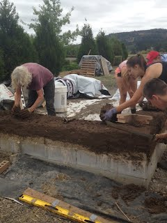 working on the cob wall