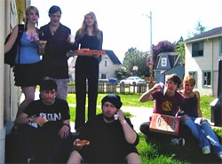 homeless teens enjoy pizza