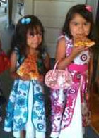 little girls with pizza