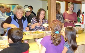 Monroe Rotary serves Thanksgiving Dinner