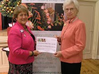 Chairman Christine Purkess presents Pam GIbson, President of Sussex Kidney Trust with a cheque for £750