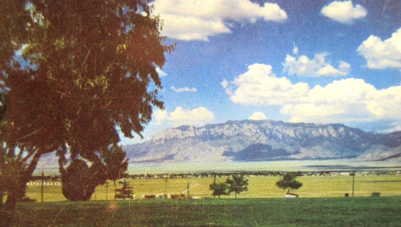 This vintage postcard provides a view of the Sandias from the Valley, circa 1952.