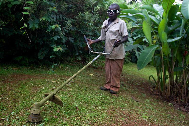 kampala kid grass trimmer phil philip bowen photo photographer uganda