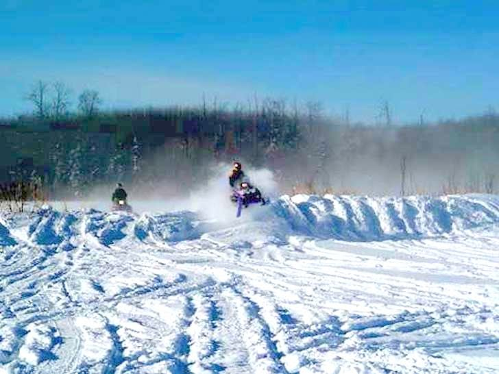 Snowmobiling in Saskatchewan near Townsend Lake