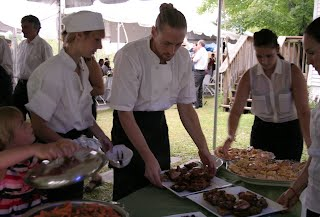 Chefs Ian and Vienna (left) with staff