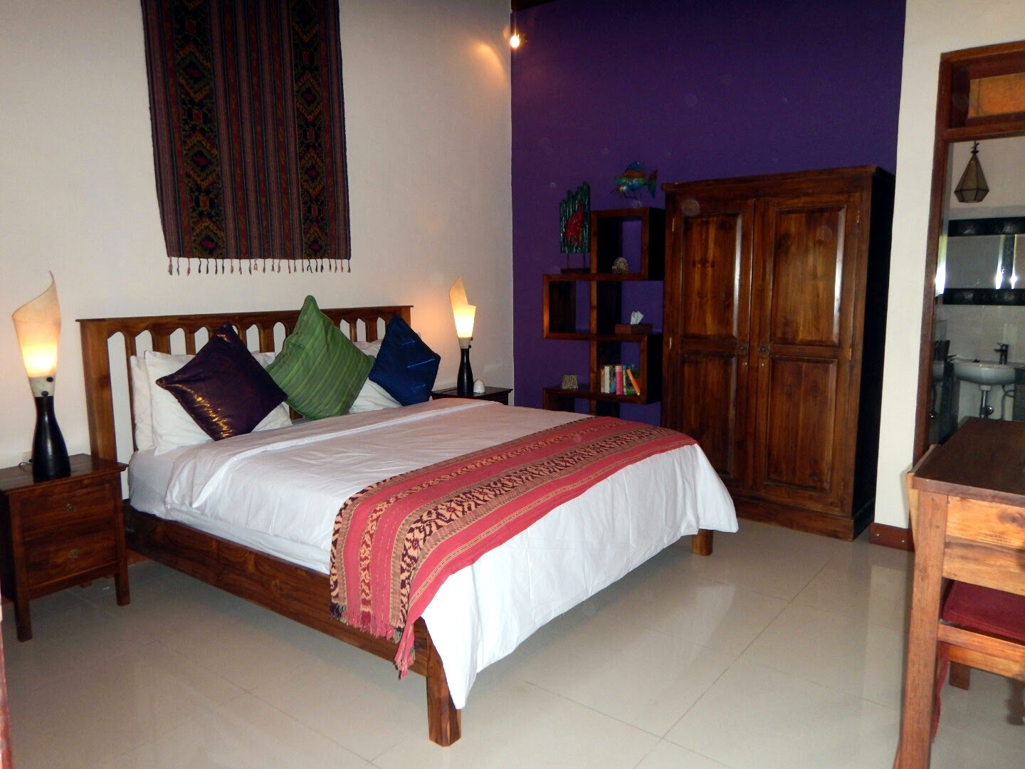 Popular Puri Sayang King and Puri Sayang Queen are superior rooms featuring teak furniture with new granite floors Teak wardrobe and desk pletes the room